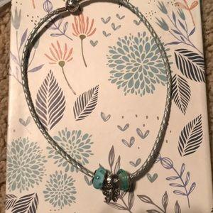 Pandora bracelet with three charms